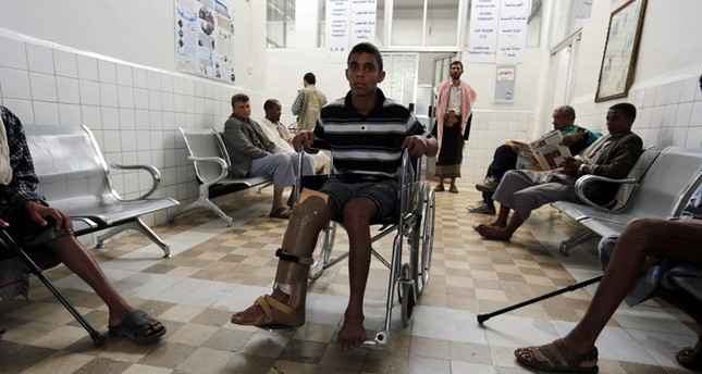 A disabled young Yemeni of the on-going conflict victims (C) waits for treatment at a rehabilitation center on International Day of Innocent Child Victims of Aggression, in Sana'a, Yemen, June 4, 2016emEPA Photo/em
