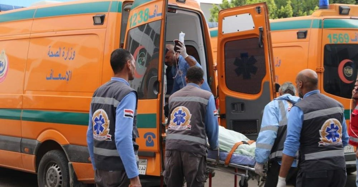 A picture released by the Suez Governorate Media Office on Dec. 28, 2019 shows paramedics transporting one of the victims who were injured in a bus crash on the road to the Ain Sokhna resort east of the Egyptian capital Cairo (Photo by Suez Governorate Media Office/ AFP)