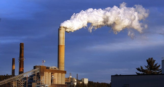 In this Jan. 20, 2015 file photo, a plume of steam billows from the coal-fired Merrimack Station in Bow, N.H. (AP Photo)