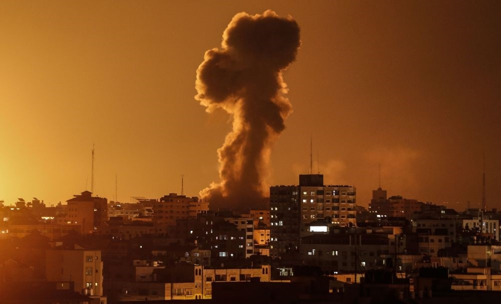 Smoke rises above the building housing the Hamas-run television station al-Aqsa TV in the Gaza Strip during an Israeli air strike, Nov. 12.
