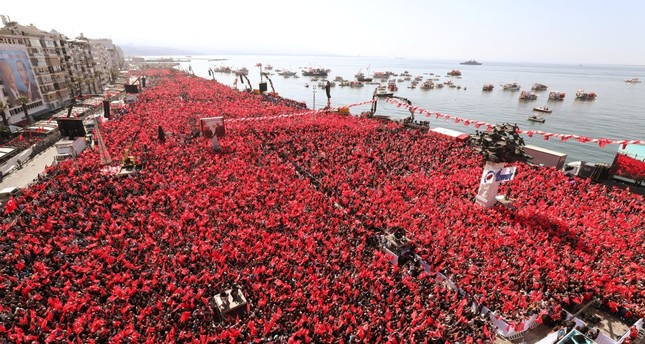President Recep Tayyip Erdoğan greets AK Party and Nationalist Movement Party MHP supporters during a rally in Izmir for the upcoming local elections, March 17, 2019.