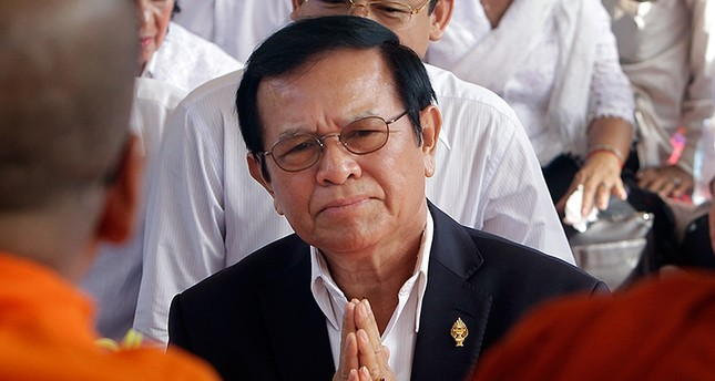 In this Thursday, March 30, 2017, file photo, opposition leader of the Cambodia National Rescue Party Kem Sokha prays during a Buddhist ceremony to mark the 20th anniversary of the attack on anti-government protesters in 1997 (AP Photo)