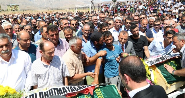 People support the father of the PKK victim siblings who feels faint during the funeral, July 16, 2019.