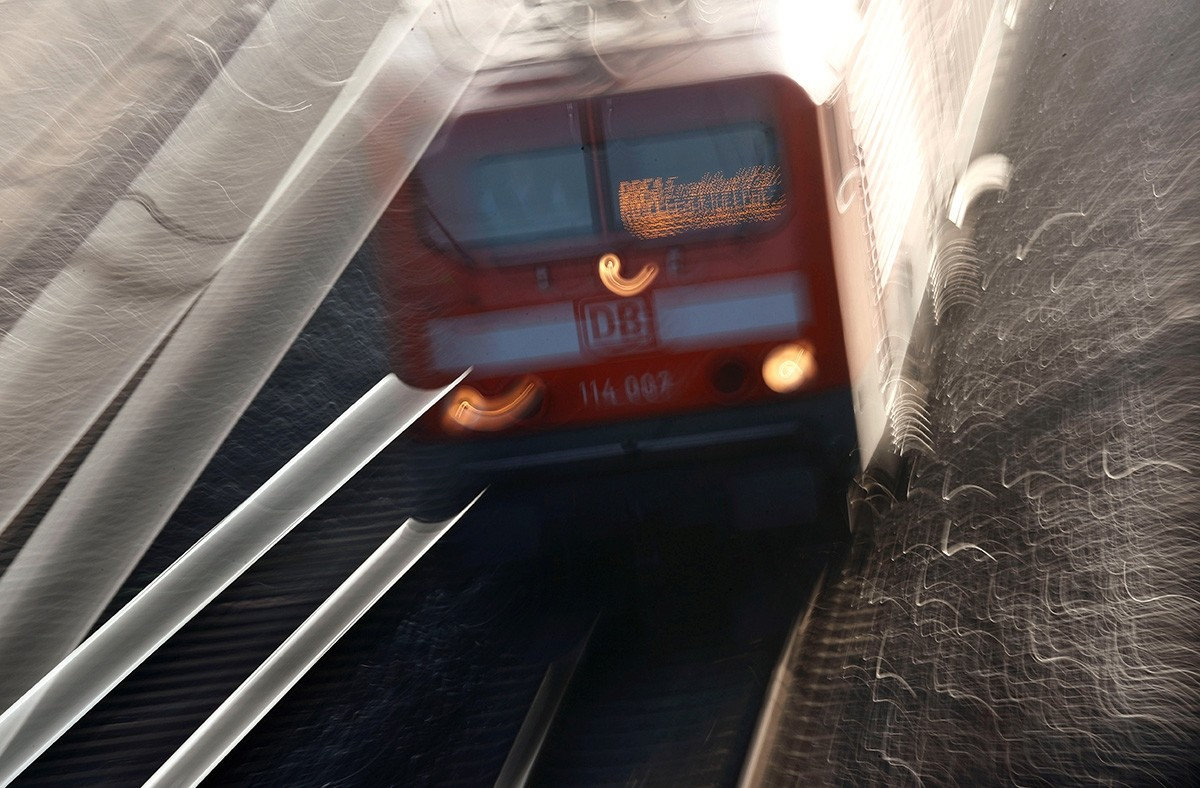 This long exposure file photo shows a regional train of German railway Deutsche Bahn AG leaves the train station in Hanau, Germany, November 23, 2018. (Reuters Photo)
