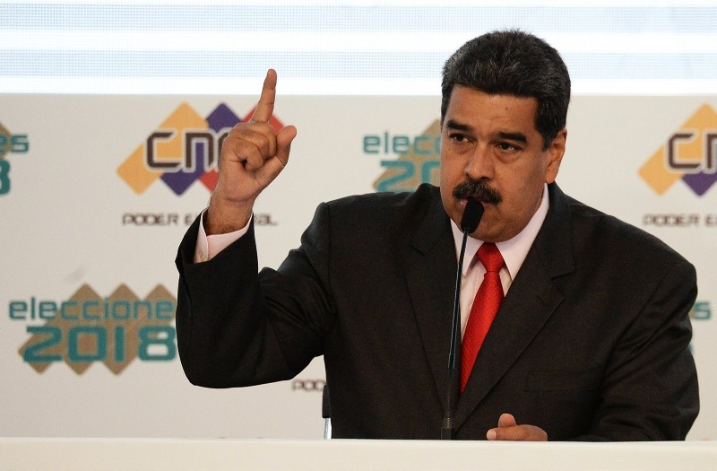 Venezuelan President Nicolas Maduro speaks at the National Electoral Council (CNE) headquarters in Caracas, during the act in which he was proclaimed as re-elected President for the term 2019-2025, on May 22, 2018. (AFP Photo)