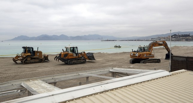 Earth movers enlarge and beautify the beach. (AFP Photo)