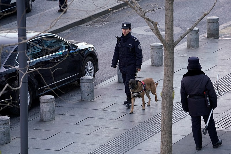 Police patrol outside the Joy City Mall in the Xidan district after a knife attack, in Beijing, China. (Reuters Photo)