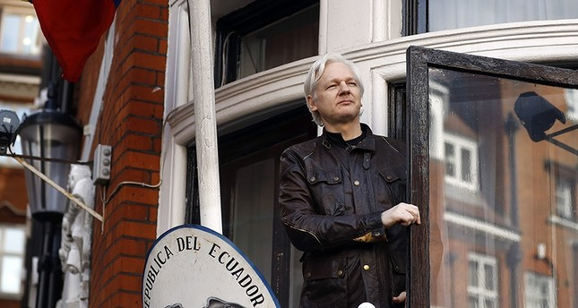 In this Friday May 19, 2017 file photo, WikiLeaks founder Julian Assange greets supporters outside the Ecuadorian embassy in London. (AP Photo)