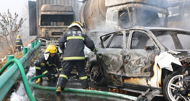 Firemen work at the site of an accident on an expressway in Fuyang in central China's Anhui province, 15 November 2017. (EPA Photo)