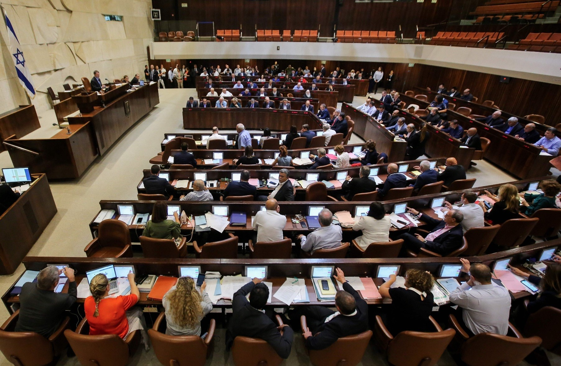 Israeli members of parliament attend the Knesset Plenary Hall session ahead of the vote on the Jewish State bill, July 18.