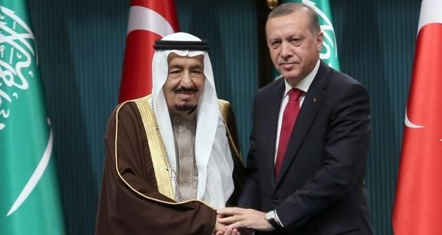 Saudi King Salman (L) and President Erdoğan shake hands at Presidential Complex in Ankara.