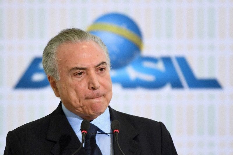 Brazilian President Michel Temer during the launching of the National Volunteer Program at Planalto Palace in Brasilia, on August 28, 2017 (AFP Photo)