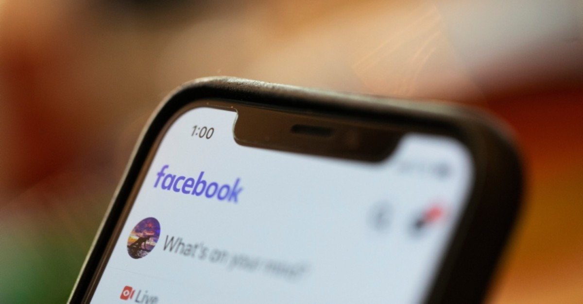In this Sunday, Aug. 11, 2019, photo an iPhone displays a Facebook page in New Orleans. (AP Photo)