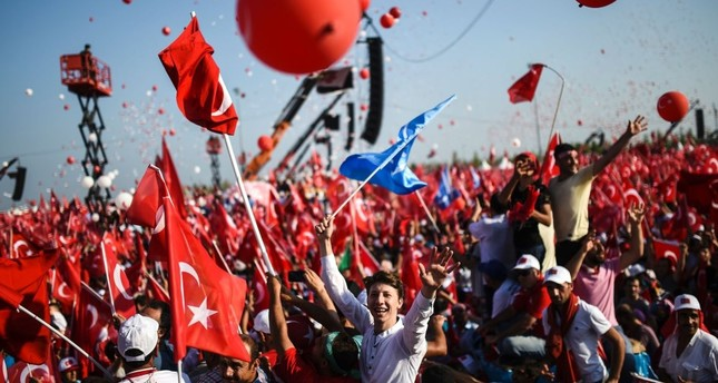 People wave Turkish flags during a rally against the July 15 coup attempt where government officials and opposition party members attended to condemn the heinous attempt, Yenikapı, Istanbul, Aug. 7, 2016.