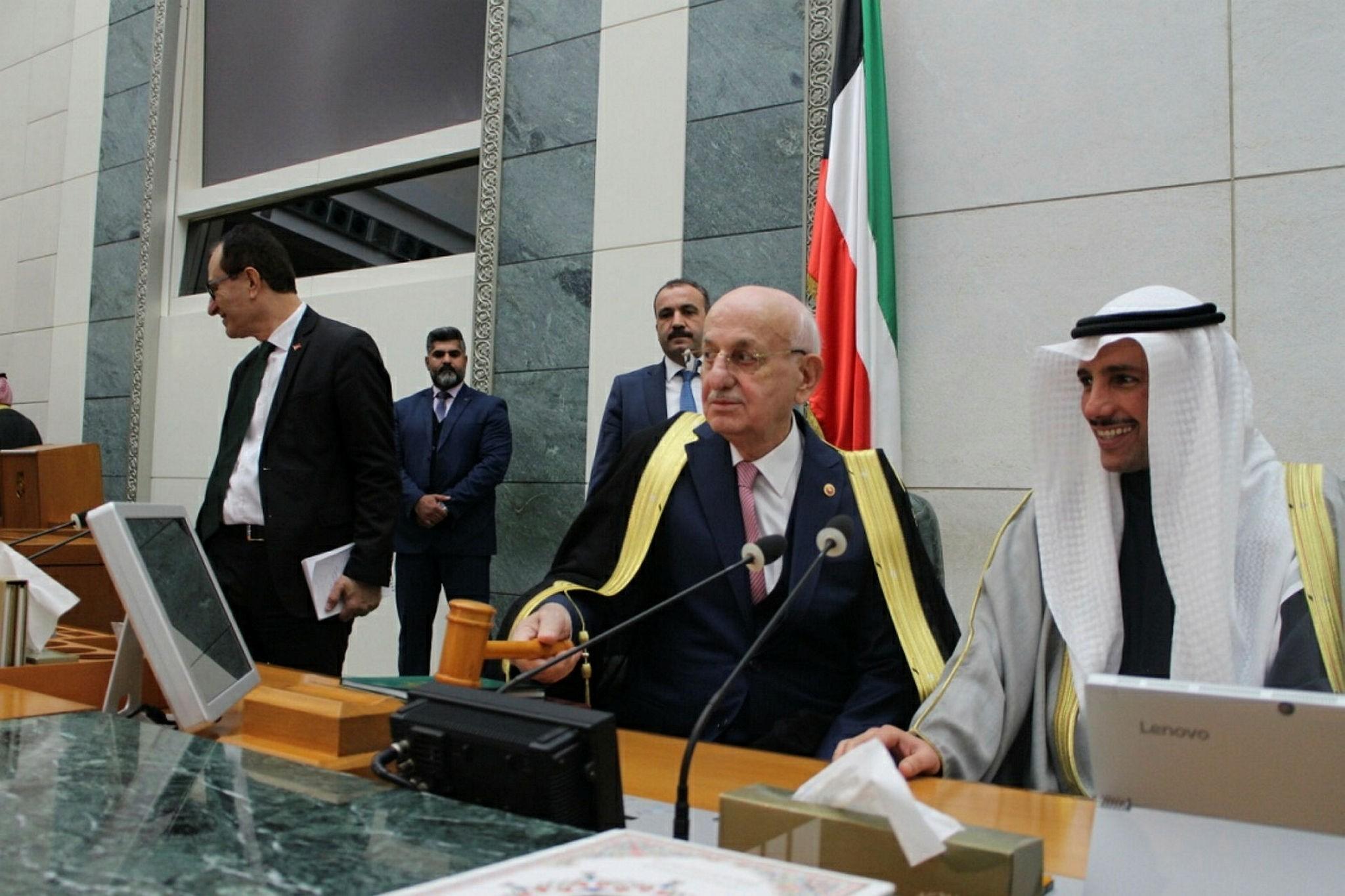 Parliament speaker Kahraman (C) and Kuwait's Marzouq Al-Ghanim (R)