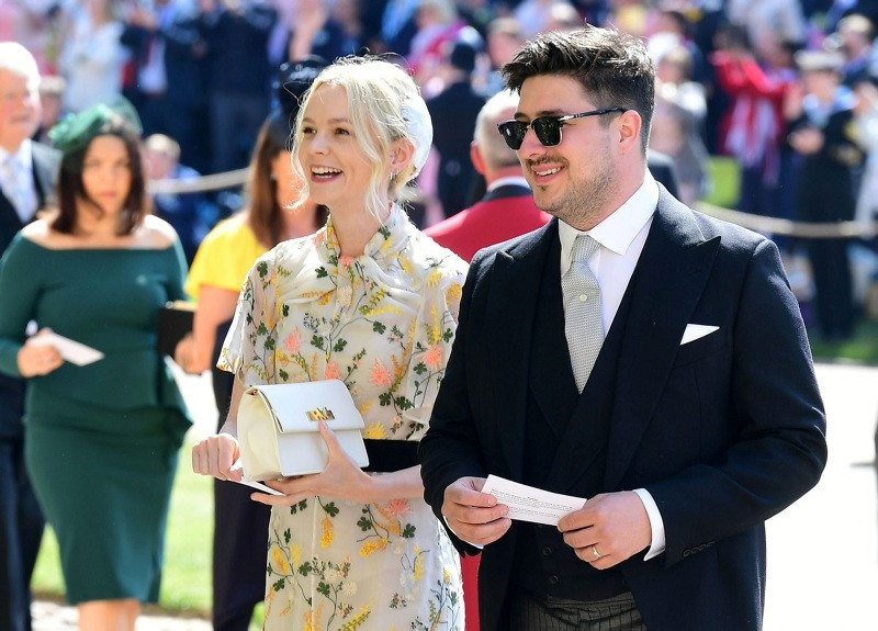 British musician Marcus Mumford and British actor Carey Mulligan arrive for the wedding ceremony of Britain's Prince Harry, Duke of Sussex and US actress Meghan Markle at St George's Chapel, Windsor Castle, in Windsor, on May 19, 2018.