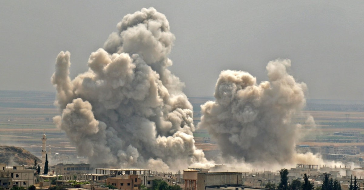 Plumes of smoke rise following reported Syrian regime forcesu2019 bombardment on the town of Khan Sheikhun in the southern countryside of the Idlib province, June 7, 2019.