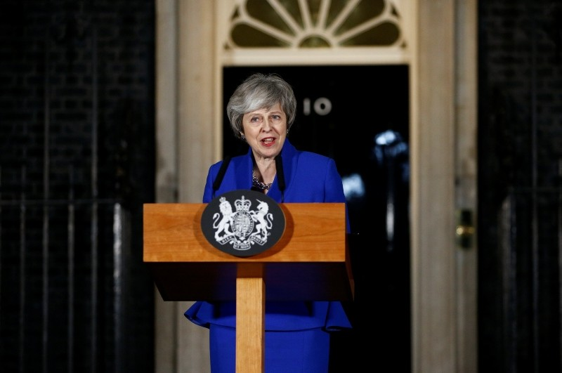 Britain's Prime Minister Theresa May makes a statement following winning a confidence vote, after Parliament rejected her Brexit deal, outside 10 Downing Street in London, Britain, Jan. 16, 2019. (Reuters Photo)