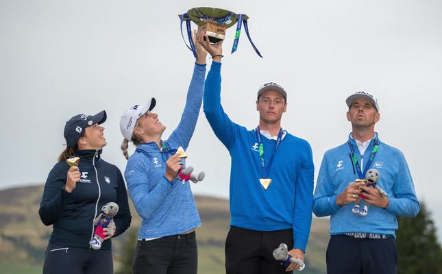 Team Iceland pose with their gold medals and the trophy after their victory during the European Championships at Gleneagles PGA Centenary Course, Scotland.