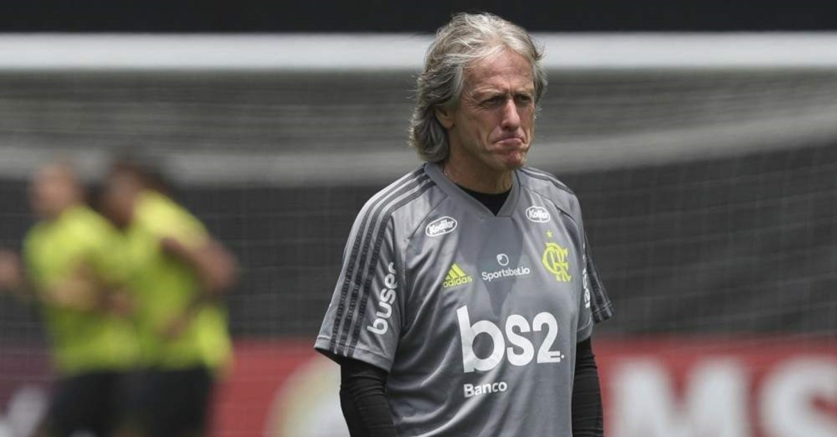 Flamengo's Portuguese manager Jorge Jesus stands on the pitch during a training session, Nov. 21, 2019. (AP Photo)