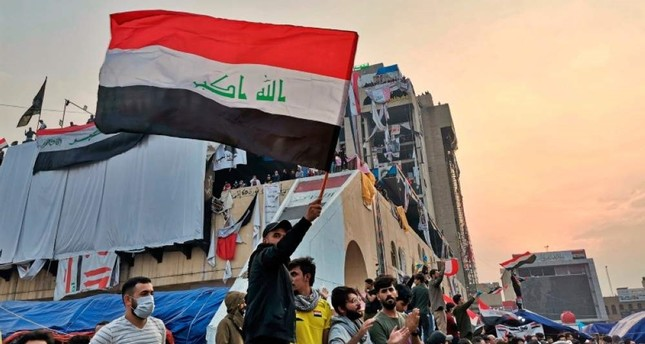 Anti-government protesters gather in Tahrir Square, Baghdad, Iraq, Friday, Nov. 29, 2019. Celebrations have erupted following an announcement by Iraqi Prime Minister Adel Abdul-Mahdi that he'd be resigning. (AP Photo)