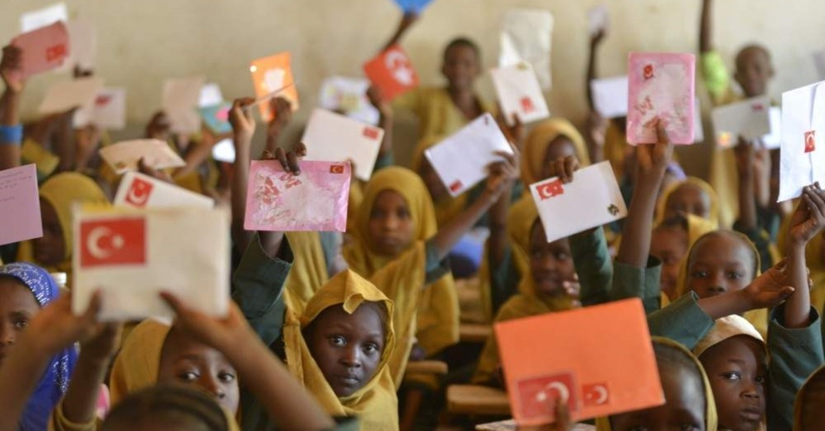African children hold up letters sent by Turkish children in this undated photo. (AA File Photo)