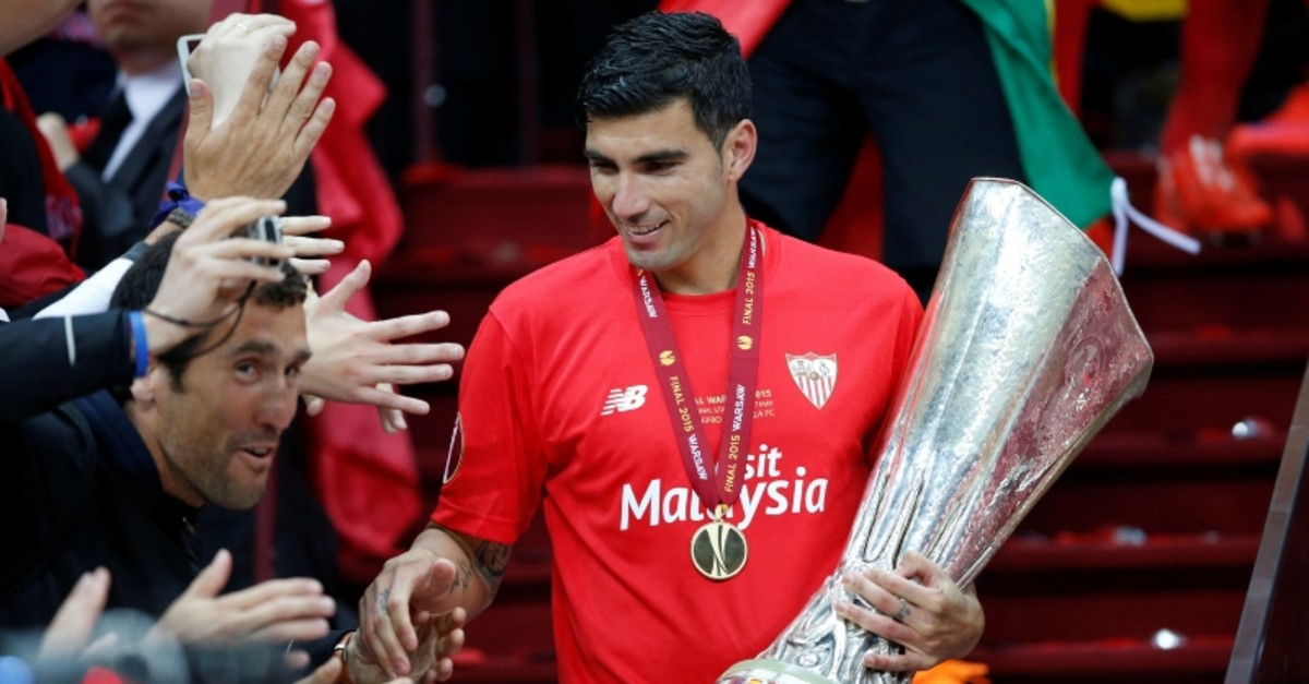 This file photo shows Sevilla's Jose Antonio Reyes celebrating with the trophy and fans after winning the UEFA Europa League Final against Dnipro Dnipropetrovsk at the National Stadium in Warsaw, Poland, May 27, 2015. (Reuters Photo)