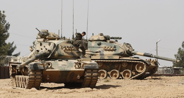 A Turkish soldier is pictured on his tank during Turkey's Euphrates Shield against Daesh.