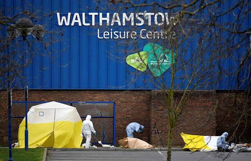 Forensic investigators examine the scene around Walthamstow Leisure Centre, where a teenage boy was shot, in London, Britain, April 3, 2018. (Reuters Photo)