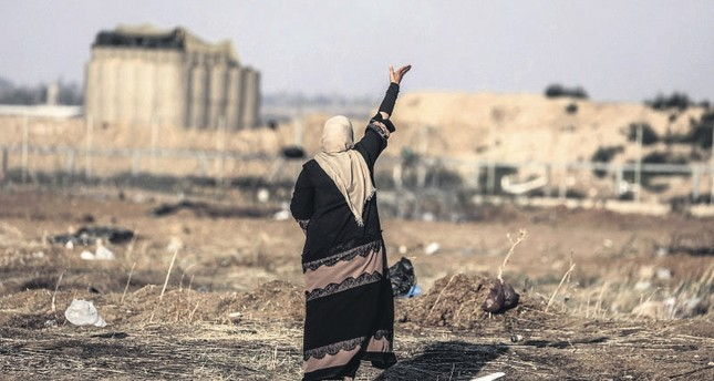 A Palestinian woman during the demonstrations to mark the Nakba, when more than 700,000 Palestinians were forcefully expelled from their villages in the war that led to the creation of the state of Israel in 1948, east of Gaza Strip, May 15.