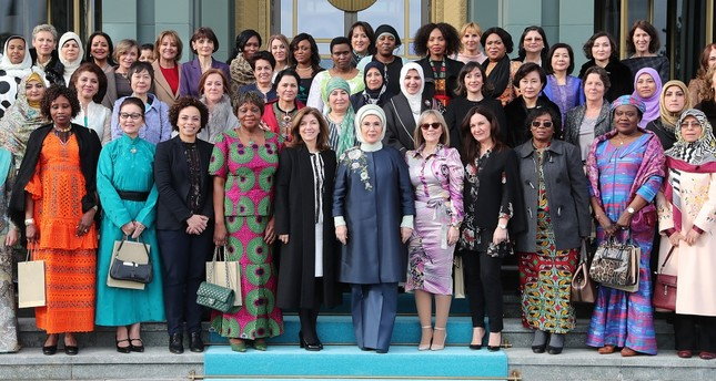 First lady Emine Erdoğan (C) alongside the spouses of foreign envoys and female ambassadors following an event at the Beştepe Presidential Complex, Ankara, Feb. 13, 2019.