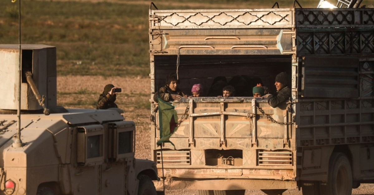 Civilians evacuated from Daesh's embattled holdout of Baghouz sit in the back of a truck, Feb. 25, 2019.