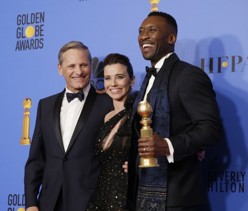 Viggo Mortensen, Linda Cardellini and Mahershala Ali pose with the award for Best Motion Picture, Musical or Comedy for 'Green Book' in the press room during the 76th annual Golden Globe Awards ceremony at the Beverly Hilton Hotel (EPA Photo)
