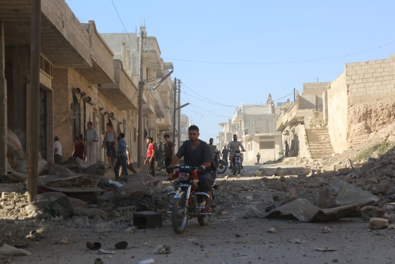 Syrian regime helicopters dropped so-called barrel bombs on civilian homes on the outskirts of the city of Khan Sheikhoun on Sept. 8, 2018. (AA Photo)