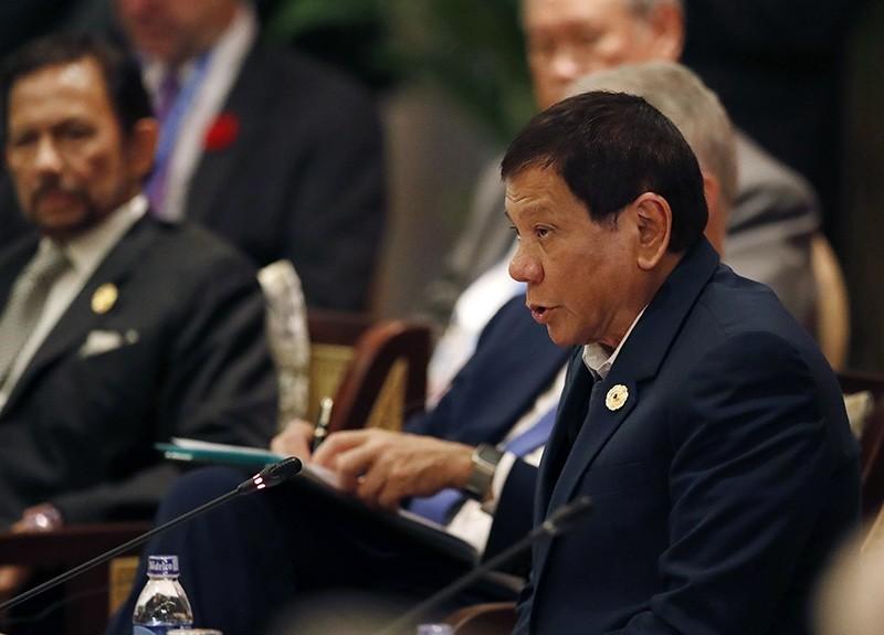 Philippines' President Rodrigo Duterte speaks next to Brunei's Sultan Hassanal Bolkiah during the APEC-ASEAN dialogue, on the sidelines of the 25th Asia-Pacific Economic Cooperation summit (APEC), in Danang, Vietnam. (EPA Photo)