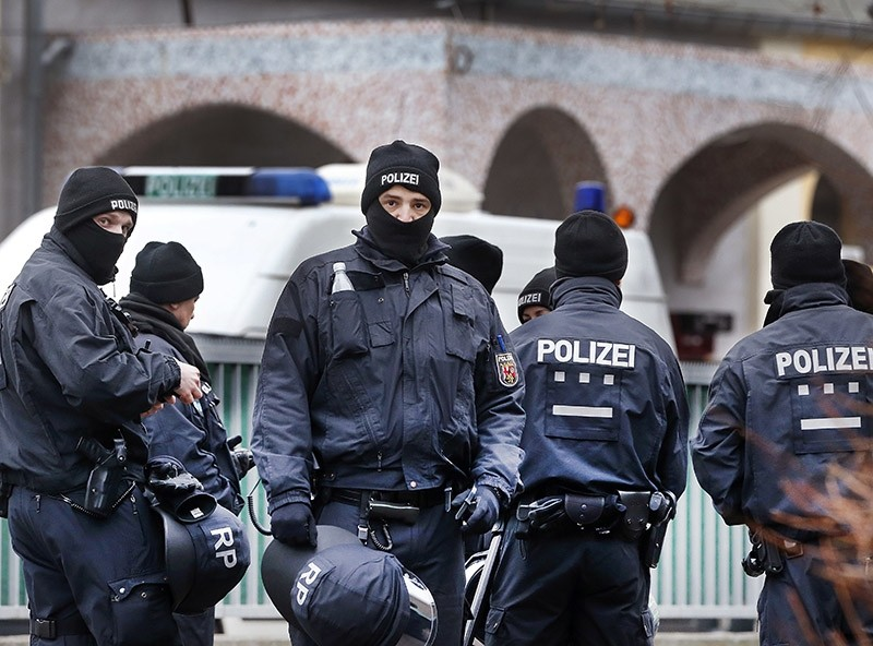 German police officers stand guard in front of a mosque during a terror raid in Frankfurt, Germany, Wednesday, Feb. 1, 2017. (AP Photo)