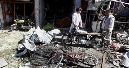 pAt least 24 people have been killed and 42 others were wounded after a car bomb struck a bus carrying government employees in western Kabul Monday, an official told AFP, in the latest attack to...