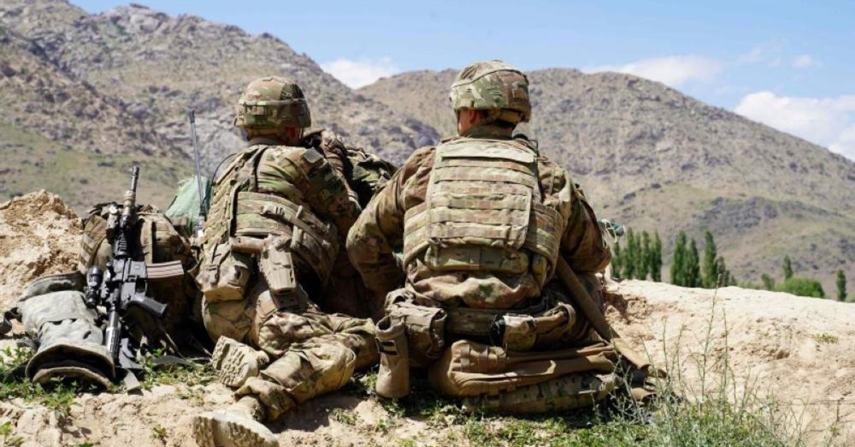 In this file photo taken June 6, 2019, U.S. soldiers look out over hillsides at the Afghan National Army (ANA) checkpoint in the Nerkh district of Wardak province. (AFP)
