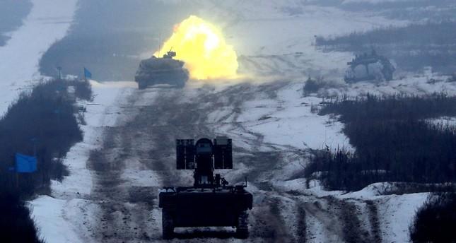 A tank fires during military exercises at the Ukrainian Ground Forces training center near Honcharivske in the Chernihiv region, Ukraine, Dec. 3.