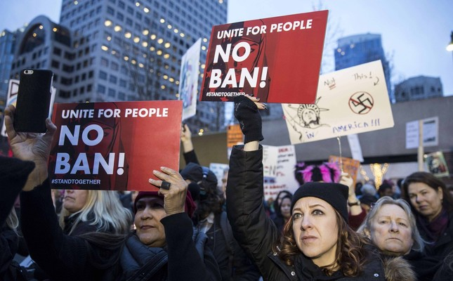 Protesters holding up signs in a demonstration against U.S. President Donald Trump's executive order banning Muslims from certain countries, Seattle, Jan. 29.