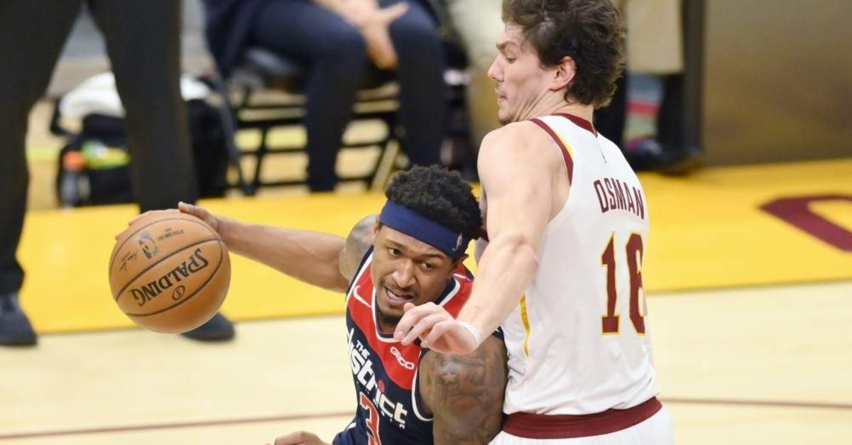 Washington Wizards guard Bradley Beal (3) drives against Cleveland Cavaliers forward Cedi Osman (16) in the fourth quarter at Rocket Mortgage FieldHouse. (Reuters Photo)