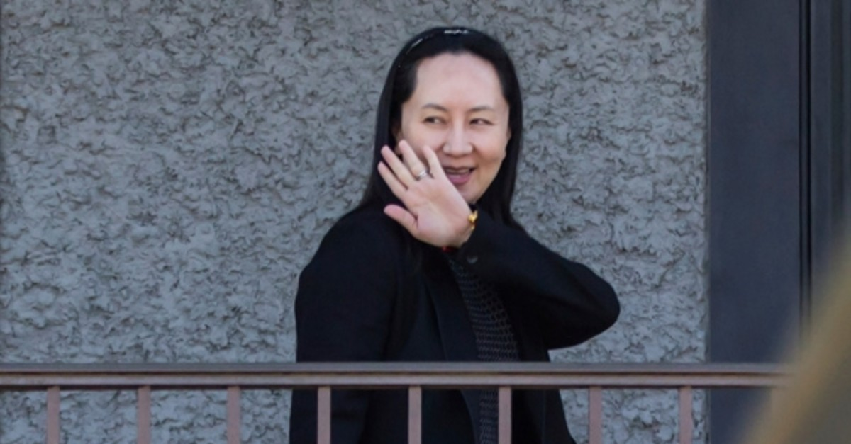 Huawei Chief Financial Officer Meng Wanzhou waves as she returns home after attending a court appearance in Vancouver, British Columbia, Wednesday May 8, 2019. (AP Photo)
