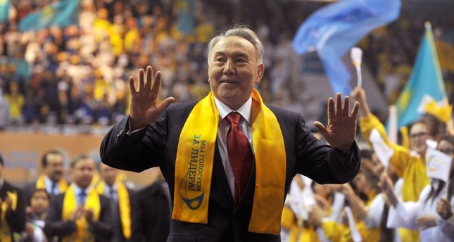 Kazakh President Nursultan Nazarbayev greets his supporters during a celebration rally at a sports center in Astana, April 4, 2011.