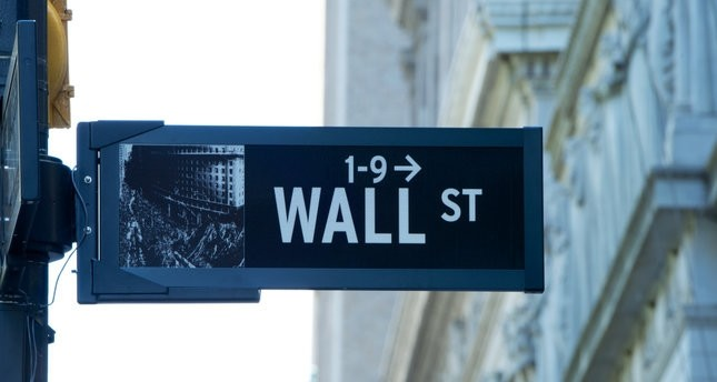 Mixed close on Wall Street as Fed raises rates