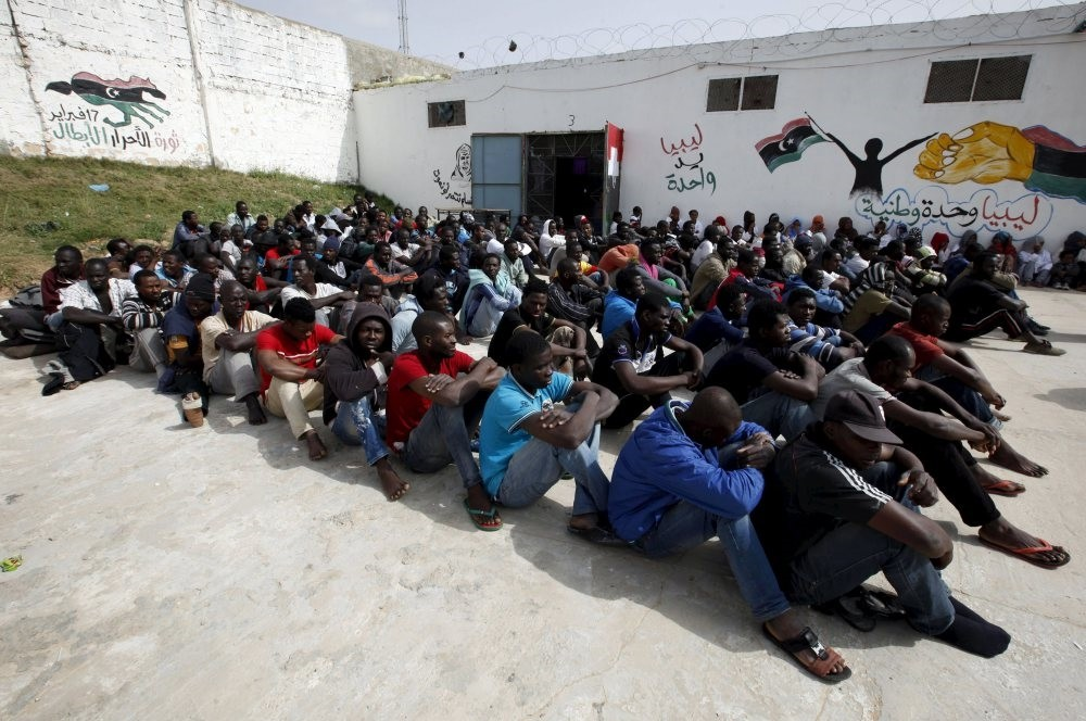 Illegal immigrants from sub-Saharan Africa sit in the Abu Saleem detention center in Tripoli, April 21, 2015.