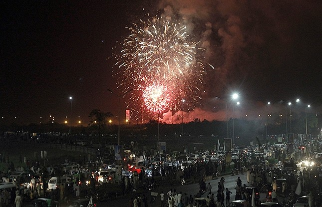Pakistan people gather to watch a firework display during Pakistan Independence Day celebrations in Islamabad, Pakistan, Sunday, Aug. 14, 2106. (AP Photo)