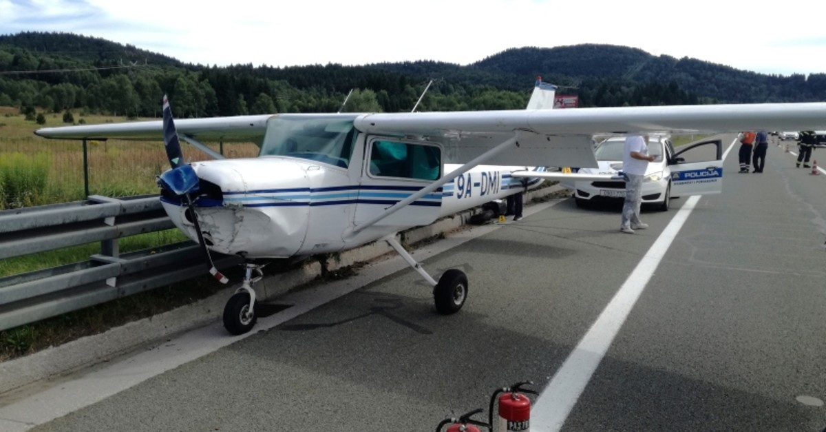 In this photo provided by Vrbovsko Fire Brigade, a small plane is parked after it made an emergency landing on a main highway in Croatia, near Vrbovsko, Saturday, Aug. 17, 2019. (AP Photo)