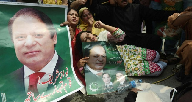 Supporters of Pakistan Muslim League Nawaz (PNL-N) protest the Supreme Court decision against Prime Minister Nawaz Sharif, Lahore, July 28.