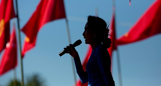 In this Oct. 17, 2015 photo, Aung San Suu Kyi speaks during a campaign rally for her National League for Democracy party in Thandwe, western Rakhine state, Myanmar. (AP Photo)
