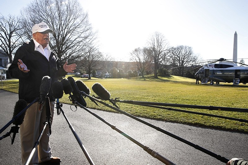 President Donald Trump speaks to the media as he leaves the White House, Thursday Jan. 10, 2019, in Washington, en route for a trip to the border in Texas as the government shutdown continues. (AP Photo)
